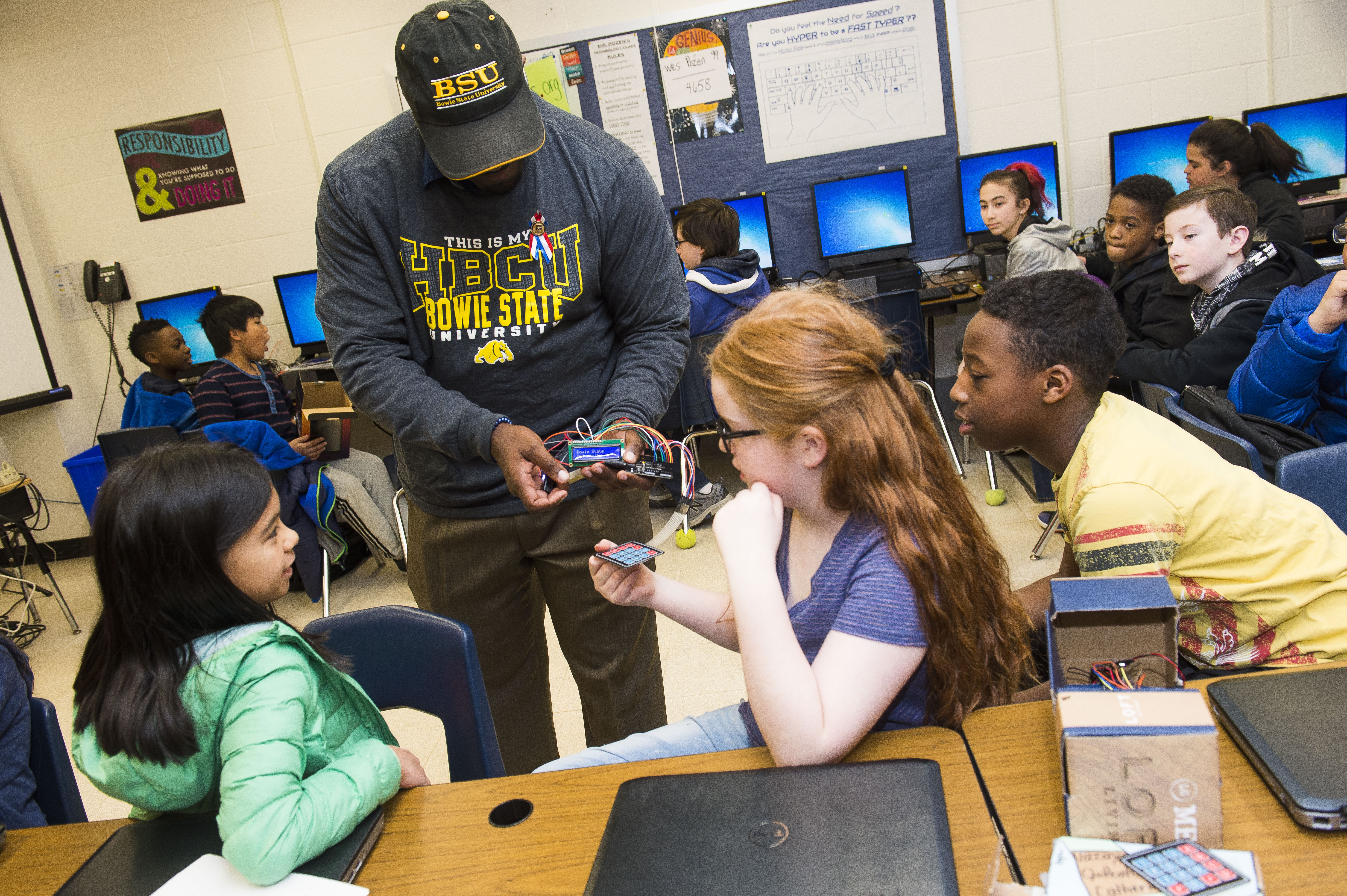 BSU volunteer work with youth on tech innovation demonstration