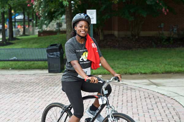 Female cyclist rides on the campus