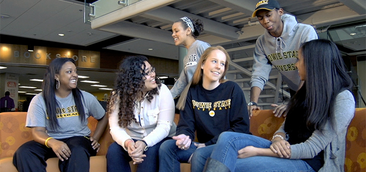 Group of students sitting and talking in the Student group at the Student Center at Bowie State University